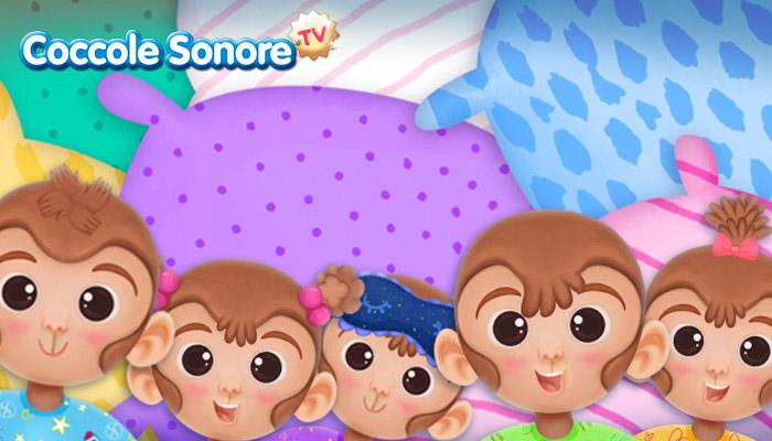Disegno di cinque scimmiette tra i cuscini