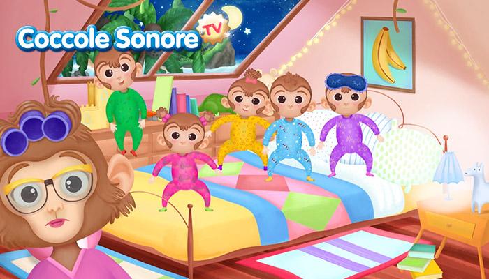 disegno cinque scimmiette saltano sul letto