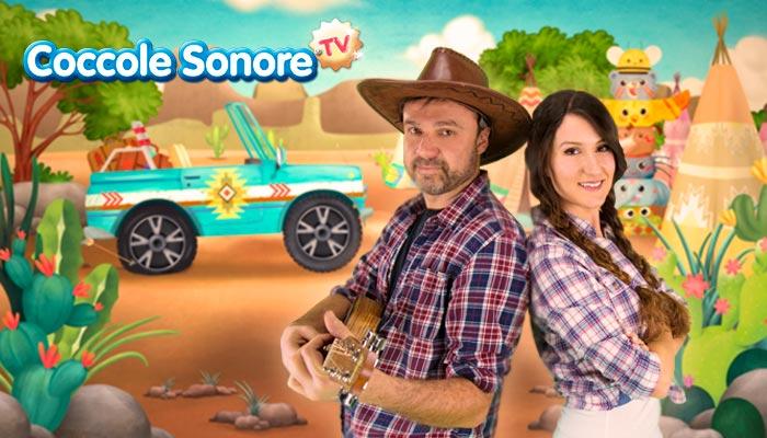 cowboy con chitarra e cappello insieme a cowgirl con le trecce nel deserto con la jeep