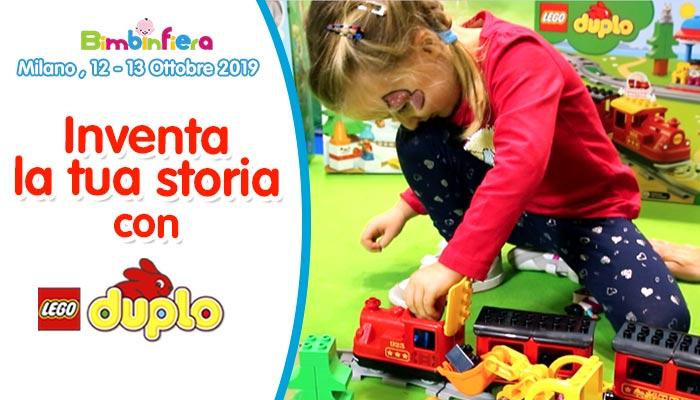 bambina che gioca con trenino Lego Duplo, Bimbinfiera Milano 2019
