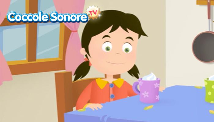 disegno di bambina sorridente a tavola davanti ad una tazza di panna, Coccole Sonore