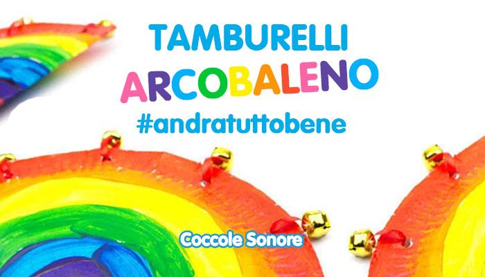 tamburelli con piatti di carta dipinti come l'arcobaleno, lavoretti per bambini
