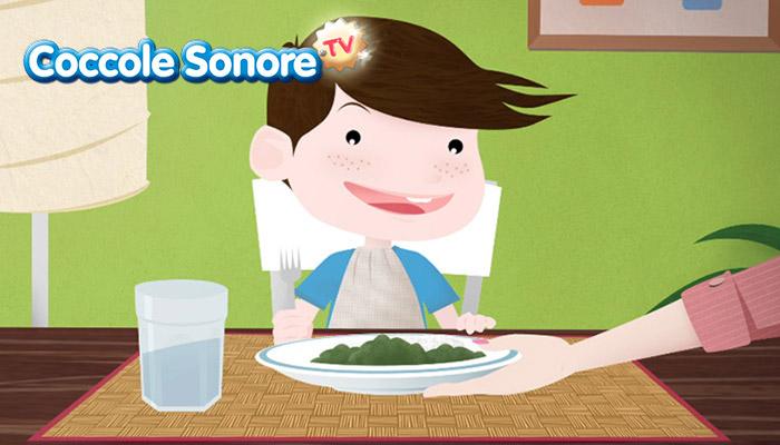 Bambino a tavola che sorride con la pappa, Coccole Sonore