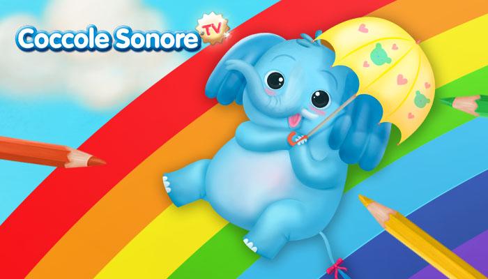 elefante con ombrello fa lo scivolo sull'arcobaleno