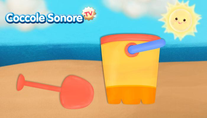 disegno di una paletta e secchiello sulla sabbia