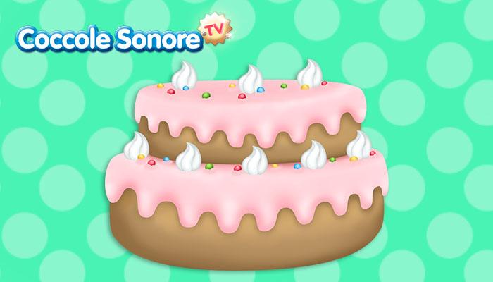 disegno di una torta con glassa rosa, meringhe e smarties